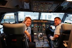 JetBlue flight crew in the cockpit at John F Kennedy International Airport in New York Royalty Free Stock Images