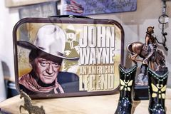 John Wayne merchandise. New York, September 25, 2017: John Wayne themed merchandise is displayed on the shelves of a store in Manhattan Royalty Free Stock Photos