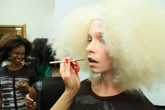 NEW YORK - SEPTEMBER 03: A model getting ready backstage for Victor de Souza Spring Summer 2015 presentation Stock Photography