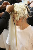 NEW YORK - SEPTEMBER 03: A model getting ready backstage for Victor de Souza Spring Summer 2015 presentation Stock Photo