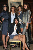 NEW YORK - SEPTEMBER 09: Models (L-R) Caroline Ribero Miranda Kerr, Alessandra Ambrosio, Morgane and Ujjwalla (sit) poses backstag Royalty Free Stock Photos