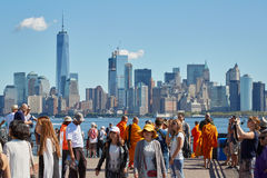 People and tourists shooting photos and New York city skyline. NEW YORK - SEPTEMBER 12: People and tourists shooting photos and looking at New York city skyline royalty free stock images
