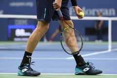 Professional tennis player Kevin Andersen of South Africa wears custom Lotto tennis shoes during US Open 2017 final match. NEW YORK - SEPTEMBER 10, 2017 Stock Photos