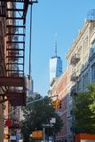 Soho street with cast iron buildings and Freedom tower in New York Stock Images