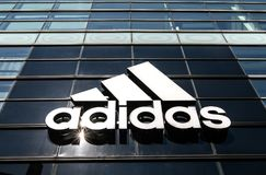 Large Adidas logo. New York, September 25, 2017: Sun shines brightly on a large Adidas logo on the exterior of their store on Houston Street Stock Photography