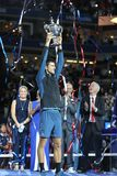 2018 US Open champion Novak Djokovic of Serbia posing with US Open trophy during trophy presentation after his final match victory Stock Photos