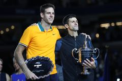 US Open finalist Juan Martin del Potro L of Argentina and champion Novak Djokovic of Serbia during trophy presentation Royalty Free Stock Photography