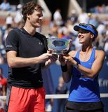 US Open 2017 mixed doubles champions Jimmy Murray of Great Britain and Martina Hingis of Switzerland during trophy presentation Royalty Free Stock Photography