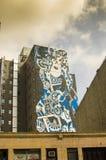 New York - September 18, 2016: Väggmålningtappning på gatorna av Arkivfoto