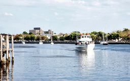 New york sheepshead bay pier fishing yacht tour. There are many fishing tours in the morning and evening in New York city, Brooklyn , Sheepshead Bay . Visitors stock photo