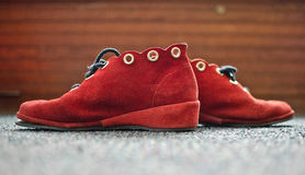 New York Shoes. A pair of red shoes on a carpeted floor Stock Photos