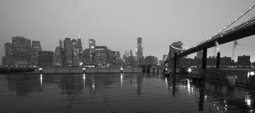 New york skyline. Skyline new york city en brooklyn bridge vieuw from brooklyn in the rain Royalty Free Stock Image