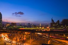 New York Skyline. At dusk with motion blur of moving train royalty free stock images