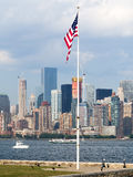 New York skyline with an american flag Royalty Free Stock Image