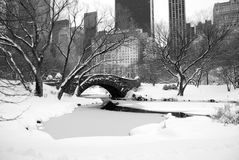New York skyline and Central Park after snow storm. View of New York City skyline and Central Park arch after snow storm - B&W Stock Photography