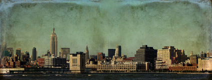 New York Skyline Grunge. New York City skyline, Lower Manhattan, with digital grunge effect Royalty Free Stock Photography