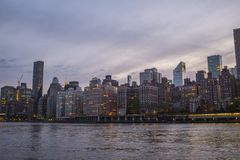 New York skyline during late afternoon. Purple sky with New York skyline in the back stock photography