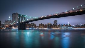 New York Manhatten Skyline by Night with brooklyn bridge royalty free stock images