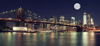 New York Skyline at night with Moon Stock Photography