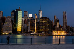 New York skyline at night with photographer Royalty Free Stock Photography
