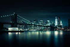 New-York skyline. By night with a reflection on the river