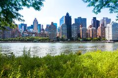New York Skyline. This is a picture taken from Roosevelt Island. The river is the east river with the east side of mid town Royalty Free Stock Image