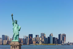 New York skyline with Statute of Liberty. In front Royalty Free Stock Photography