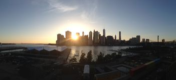 New York Skyline Sunset. From Brooklyn Heights, USA Stock Photos