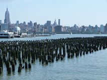 New York Skyline. View of manhattrn from New Jersey, over the broken jetty's of the historic ferry terminal Royalty Free Stock Photography