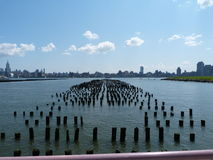 New York Skyline. View of manhattrn from New Jersey, over the broken jetty's of the historic ferry terminal Stock Photography