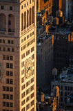 New York skyscraper at sunset with rooftop wooden water tanks Stock Photography