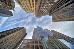 Skyscrapers in New York city. Low angle view looking to the top of tall skyscrapers in Manhattan, New York city, U.S.A Royalty Free Stock Photography