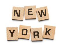 New York Wood Tiles. New York Spelled with Wood Tiles Isolated on a White Background stock photo