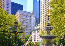 New york spring with green leaves and classic and modern architecture in lower manhattan financial district with water fountain. royalty free stock photos