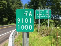 New York State Highway Reference and Welcome Signs. CONKLIN, N.Y. - JULY 8, 2018: A highway reference marker and welcome sign are posted on the northbound side Royalty Free Stock Photos