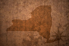 New york state map on a old vintage paper background. New york state map on a old vintage crack paper background royalty free stock photography