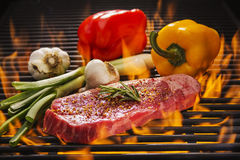 New York Steak on Flaming Hot Grill Royalty Free Stock Images