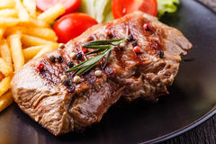 New York steak with french fries Stock Images