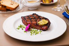 New York steak. With herb butter on a plate Royalty Free Stock Photos