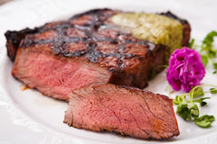New York steak. With herb butter on a plate Royalty Free Stock Photo