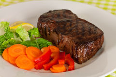 New York Steak- meat on Green Beans,Carrot,Pepper Stock Image