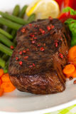 New York Steak- meat on Green Beans,Carrot,Pepper Royalty Free Stock Photos