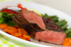 New York Steak- meat on Green Beans,Carrot,Pepper Royalty Free Stock Images