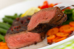 New York Steak- meat on Green Beans,Carrot,Pepper Stock Photography