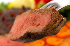 New York Steak- meat on Green Beans,Carrot,Pepper Royalty Free Stock Photography