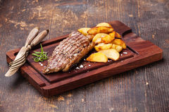 New York Steak with roasted potato wedges Stock Image