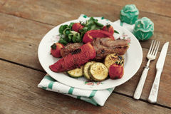New York steak with vegetables, toned image Stock Photography