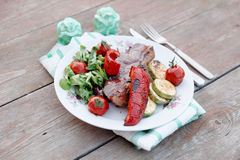 New York steak with vegetables, toned image Royalty Free Stock Photography