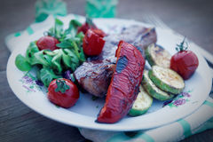 New York steak with vegetables, toned image Stock Image