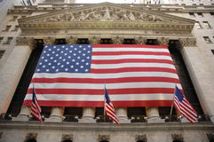 New York Stock Exchange. Lower Manhattan, New York City, USA.  Flag hanging on front side of building Royalty Free Stock Image
